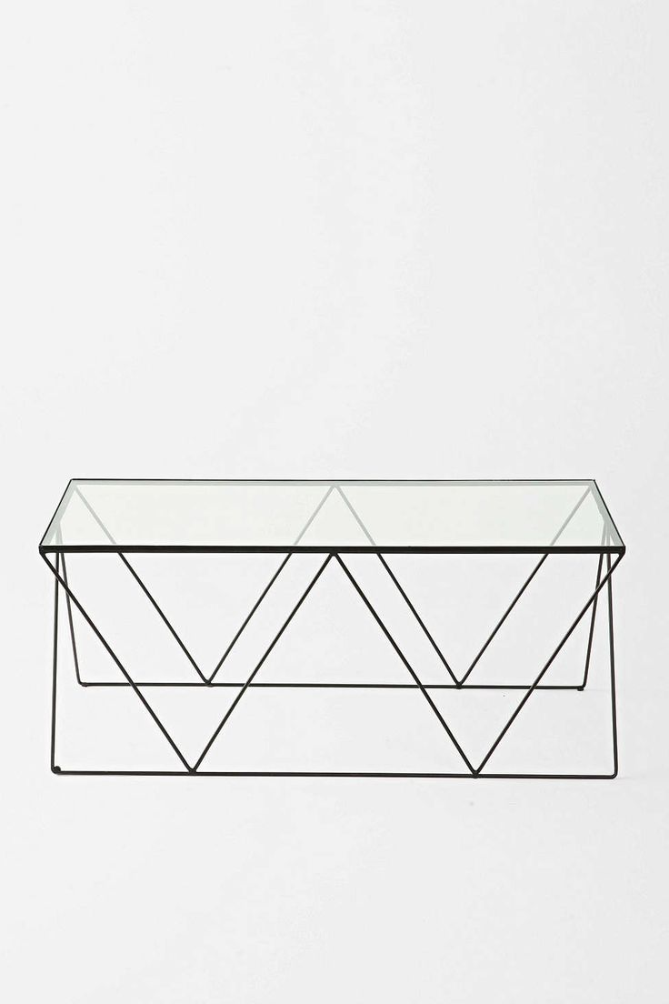 "Magical Thinking Diamond Coffee Table Minimalist-inspired coffee table in an eye-catching diamond design, from Magical Thinking. Propped up on a sturdy metal frame and complete with a glass tabletop. UO Exclusive.   Content + Care - Glass, metal - Wipe clean - Imported  Size - Length: 36"" - Width: 15.5"" - Height: 16"""