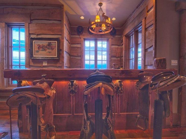 Eclectic Bar with Wood plank bar top, Saddle Bar Stool, Saddle bar stools, Buffalo Hunt Chandelier