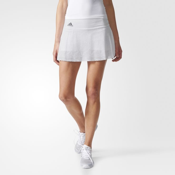 Powerful groundstrokes and uncanny speed define the game of Simona Halep. Salute her aggressive style in this women's tennis skirt. It's made of stretchy, breathable fabric that keeps you cool and dry as you work your way to the net. With an allover graphic print and a smoothing waistband, the skirt includes built-in tights for added coverage and UV protection to help block harmful rays as you serve for the win.