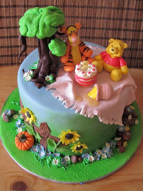 Pooh and Tigger birthday cake -     Yellow butter cake with caramel cream, french vanilla buttercream and toasted hazelnuts.