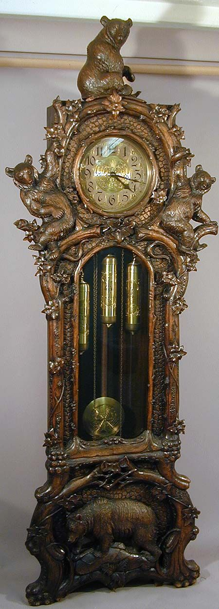 a fantastic carved bear grandfather clock, swiss ca. 1900.