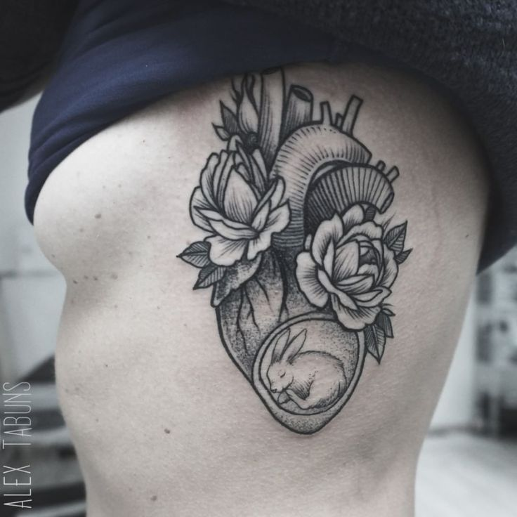 Heart tattoo- so pretty and feminine, love the little bunny.