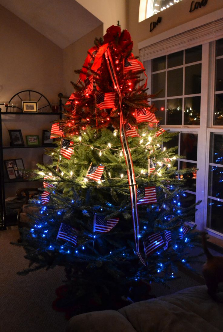 My patriotic Christmas tree.. I got this idea while my husband was overseas.: