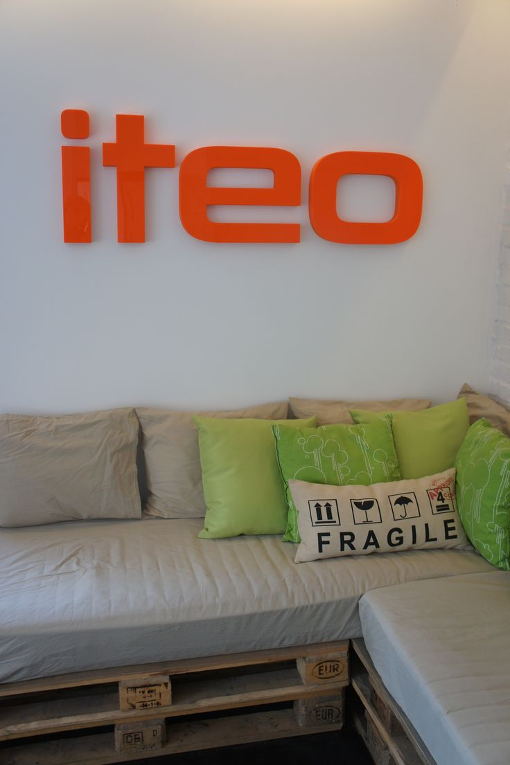 #wall #restzone #logotype #pallets #sofa #pillows #eco