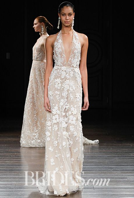 "Brides.com: Naeem Khan - Spring 2017 ""Dominica"" ivory hand-embroidered long-sleeve fitted wedding dress with plunging V-neck and open back, Naeem KhanPhoto: Gerardo Somoza / Indigitalimages.com"