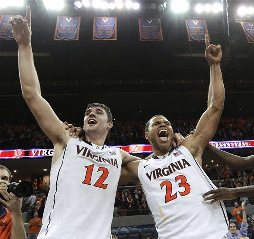Virginia's Joe Harris (12) and Justin Anderson (23) celebrate Virginia's 73-68 win over Duke in an NCAA college basketball game Thursday, Feb. 28, 2013, in Charlottesville, Va. Harris had 36 points.