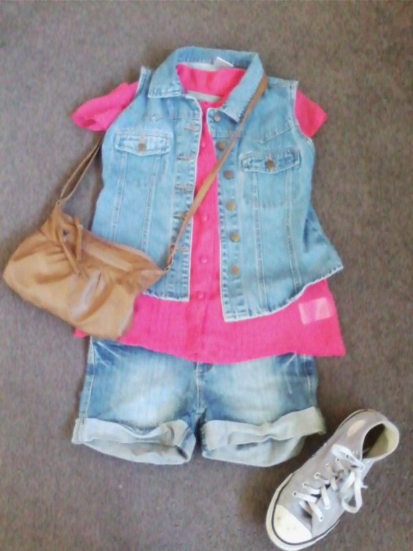 Denim vest with pink see through top with a white singlet under, denim shorts and purple converse shoes. Aldo a brown fake leather handbag.