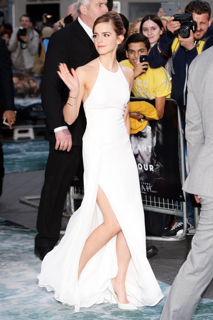 The Emma Watson Guide To Etiquette: If you are wearing a thigh-high slit, the key is to use magic powers so that it never blows awkwardly out of place or reveals more leg than you would prefer.