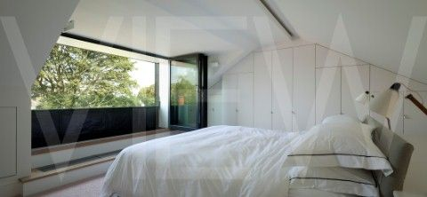 Victoria Park House Ian Hay Architects London 2010 Master bedroom in loft conversion with folding do