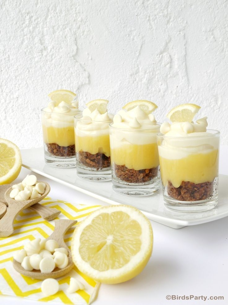 @birdsparty totally turned up the summer flavor (and the cute!) with these adorably delicious lemon cheesecake parfaits! This quick and easy summer no-bake dessert recipe needs just a microwave, a few simple ingredients and our Premiere White Morsels to create these zesty little bursts of summer-fun in single-serve glasses.