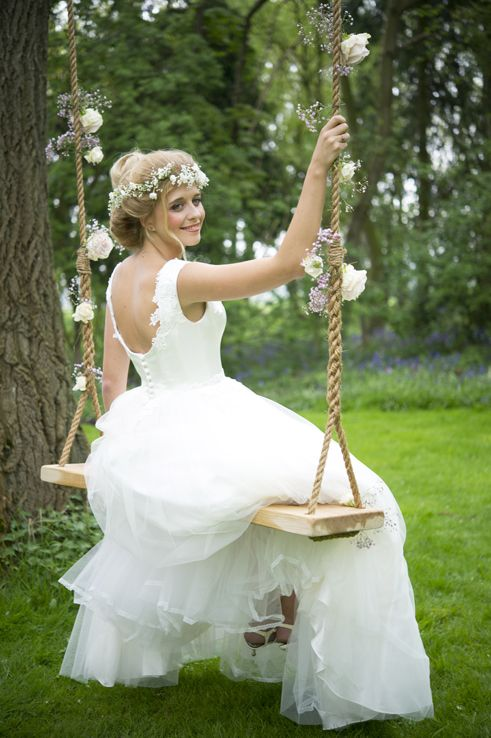 A wedding tree swing dressed in classic English country garden style