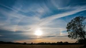 Cirrostratus clouds. It's common to see the ring around the sun when there are cirrostratus clouds in the sky.