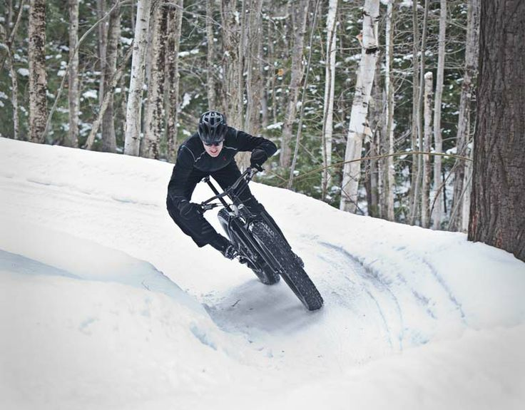 Mike Brunet takes a tight turn with his fat bike on a portion of the Noquemanon Trail Network in Marquette, MI on Monday, March 17, 2014.  (...