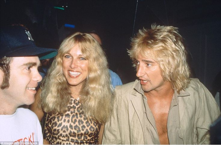 Celebrities were frequently pictured socializing together at Studio 54, such as (from left to right) Elton John, Alana Hamilton and singer Rod Stewart