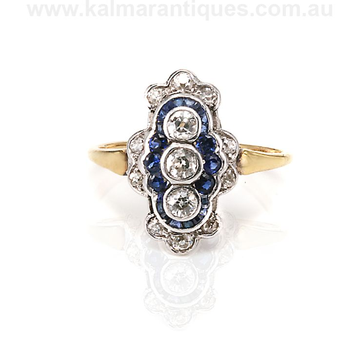 http://buff.ly/2cPEpZJ | This exquisite Art Deco #diamond and #sapphire ring uses a combination of gold and platinum in its unique handmade design. | It is available for $4900 from www.kalmarantiques.com.au