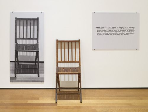 "Joseph Kosuth  One and three chairs, 1965 Wood folding chair, mounted photograph of a chair, and mounted photographic enlargement of the dictionary definition of ""chair""  chair 82 x 37.8 x 53 cm, photographic panel 91.5 x 61.1 cm, text panel 24 x 61.3cm Joeseph Kosuth"