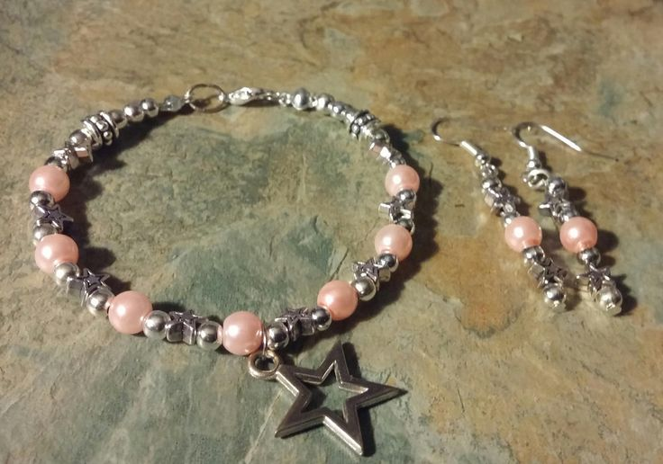 Silver stars charm bracelet, with pearl pink bead and silver stars detail, handmade original. by SpryHandcrafted on Etsy