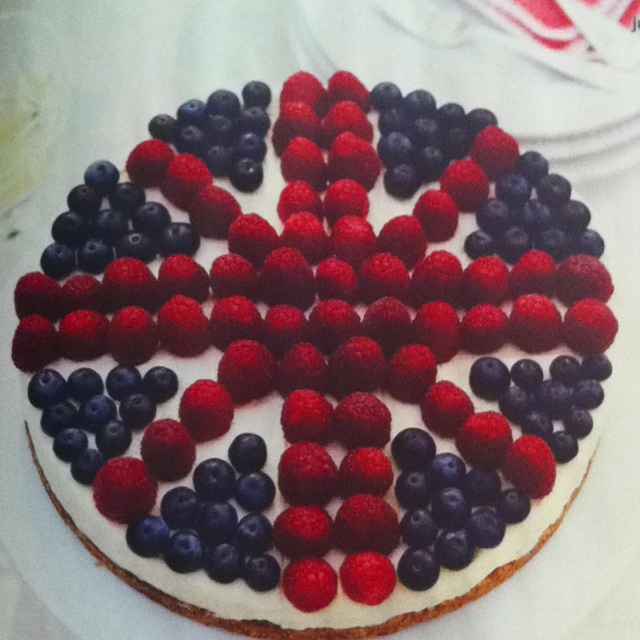 Cheesecake topped with raspberries and blueberries. Perfect for a Jubilee party!