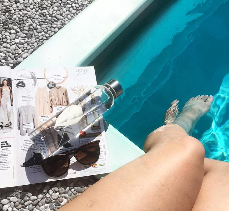 things you need on a sunny day at the pool: EQUA bottle filled with water, sunnies and a magazine #myequa #reusablebottles #glassbottles