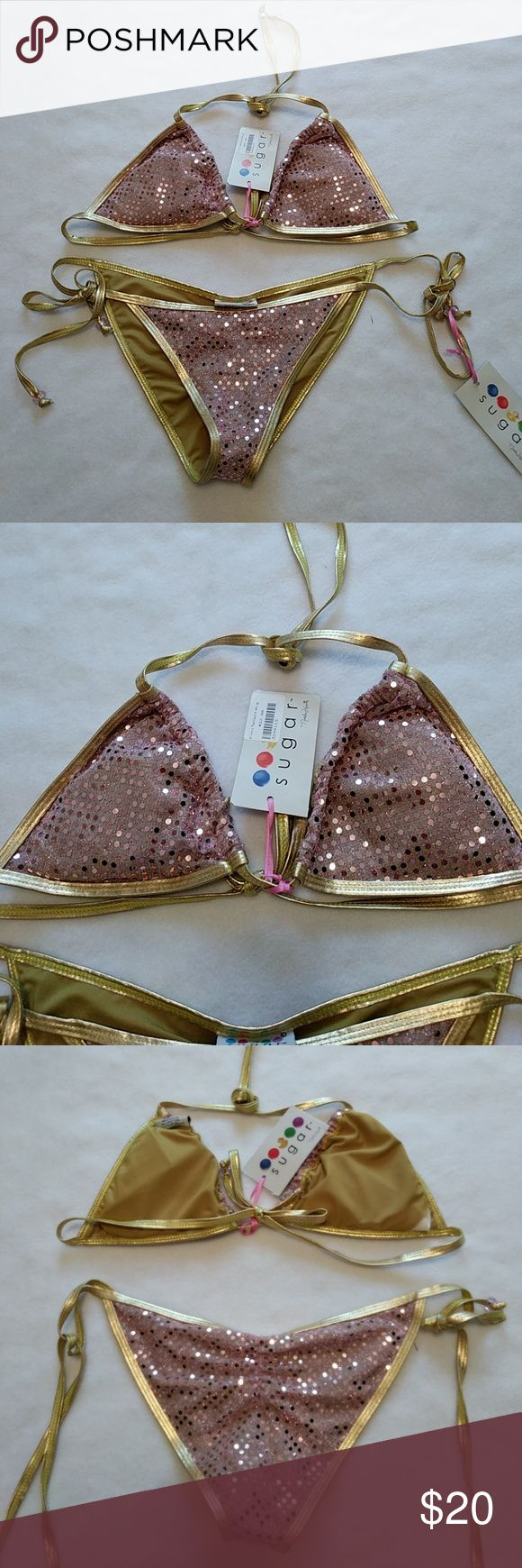 Sequin bikini This is so gorgeous! You will get so many compliments on this. It is gold with pink sequins on it sugar Swim Bikinis