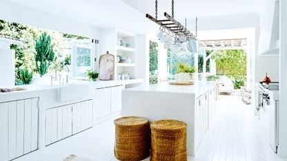 These are the most popular kitchens in Vogue Living: Smoothed edged cement on the island bench, a white farmhouse sink and all-white everything create a calm, peaceful and relaxing environment in this Mediterranean-inspired kitchen.
