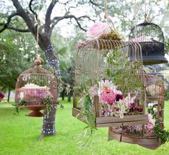 birdcage floral decor...lovely idea