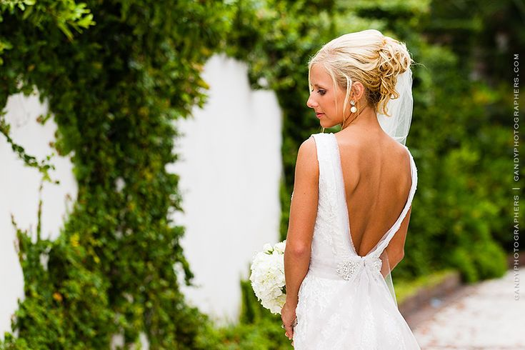 This bridal gown with a low cut back is so sexy!