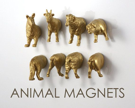 Easy DIY to do for your fridge! just cut small plastic animal toys in half and glue with E-6000 a strong magnet behind :)