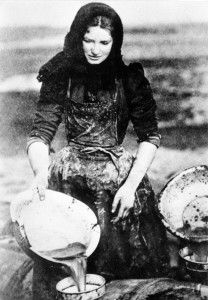 Topping up barrel with brine - from the Scottish Fisheries Museum Photograph Collection, Anstruther, Scotland.