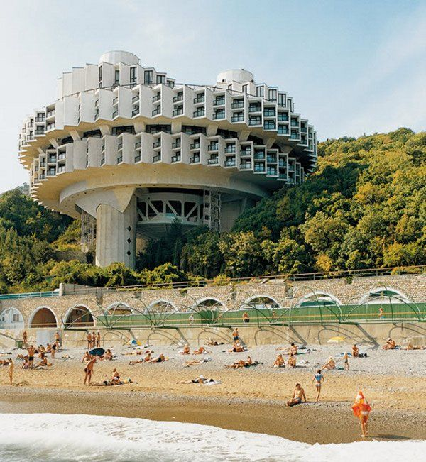 Soviet Brutalism on the beach. this  a great solution to provide each a room with a view. excellent design approach