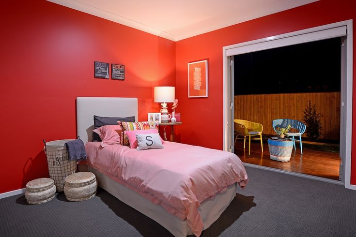 Kids bedroom. Red wall.