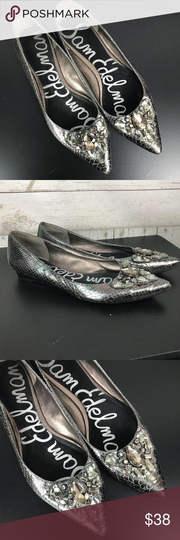 Sam Edelman Silver Jewel Flats ICELYNN 8.5 Same Edleman slip on iridescent silverballet flats. Pointy toe with lots of jewels. Silver heel. Gentlyused condition,small chipin the silver on the heel, not very noticable. Comfy! I really want tokeep them, but I wear a size 9 and they are just a little too small.  Size: 8.5 Heel Height: Flat Platform Height: N/A SB1 Sam Edelman Shoes Flats & Loafers