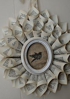 Must make this! I love decor fashioned from old books, even if it does pain me just a tiny bit thinking about those old books being torn up...