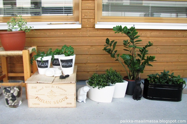 Wine crate and plants on balcony