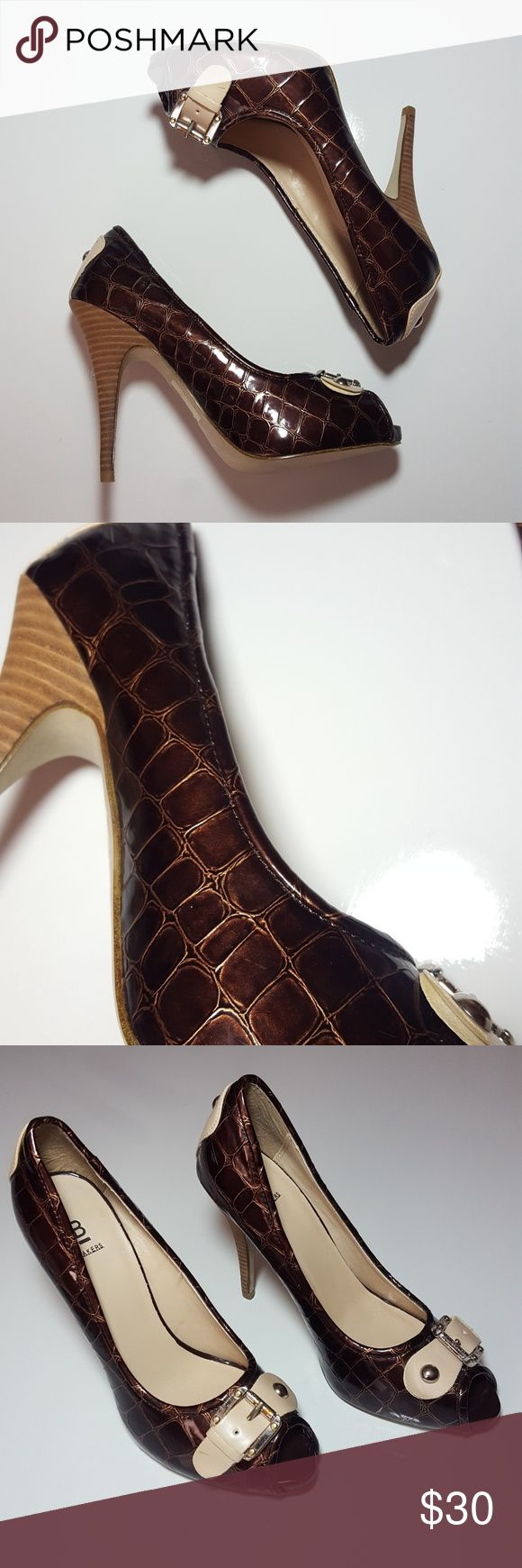♀ BAKERS womens 7 1/2 faux croc print pumps Pre-owned and hardly worn.  There are a few marks on the shoes as seen in the pictures.  These open-toe high heels feature beautiful hues of brown and copper.  Check out my other Burberry, Zara, Nike, Under Armour, J Crew, Vince Camuto, TOPSHOP, Coach, Michael Kors, Forever 21, Kate Spade, and Lacoste items. Bakers Shoes Heels