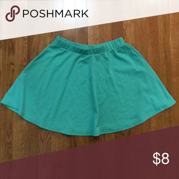 Bright, mint green skirt Bright, mint green skirt with flowy bottom and elastic waistband, fits like a large Wet Seal Skirts Mini