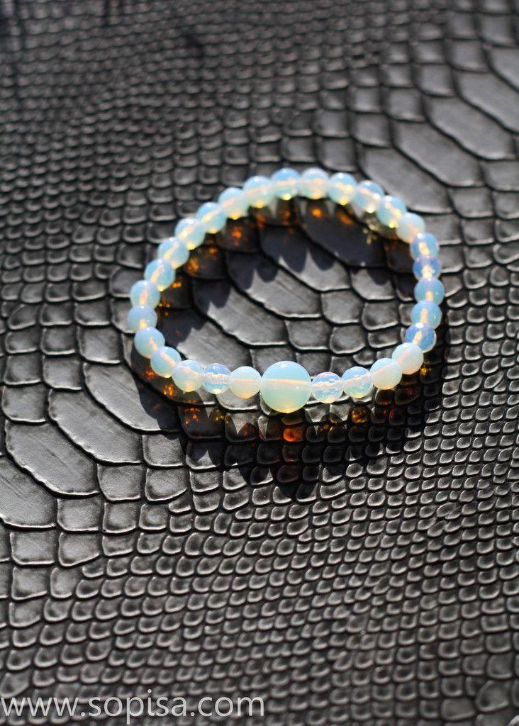 Dragon opal bracelet creating fire shadows. Sopisa #bracelets #opalbracelet #opals #opal #dragon #dragons #fantasy