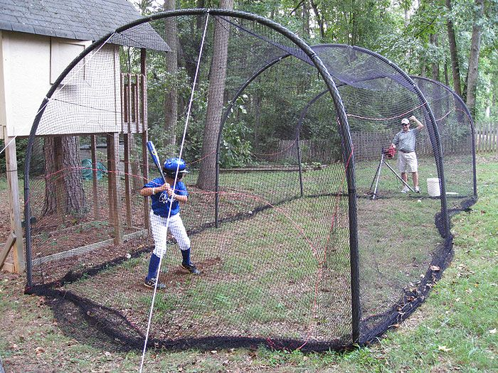 Backyard Batting Cage with Pitching Machine I'm quite sure we will have one for the kids