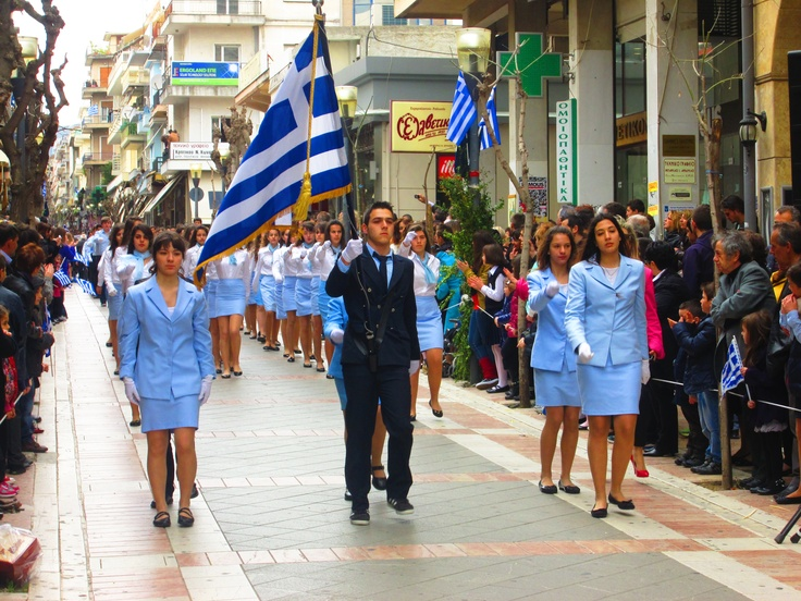 Holding the 'I Galanolefki' flag.