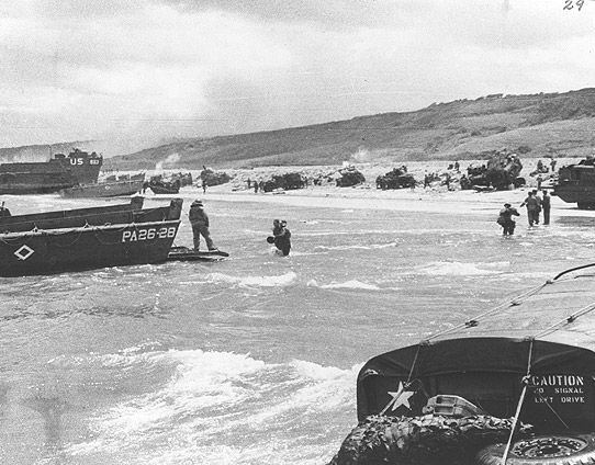 Tanks land at OMAHA Beach with assault troops in the D-Day Invasion on June 6, 1944.