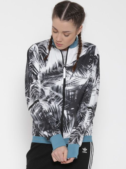 Your athleisure look is incomplete without a cool jacket. Pick up this tropical printed one to complete that stunning outfit. Adidas,Stella McCartney,Palm leaf print jacket,light jacket,Athleisure,Athleisure wardrobe,cool jacket