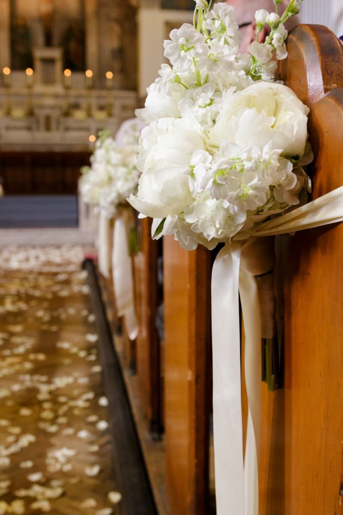 Wedding reception ideas. Pew end flowers here look like peonies, with possibly dahlias?