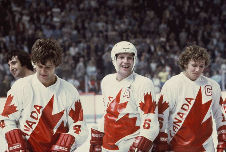 Bobby Orr (4), Denis Potvin (6) and Bobby Clarke (16) of Team Canada celebrate a win against Czechoslovakia after the Canada Cup Final held ...
