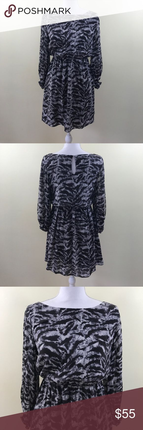 """Alice + Olivia grey animal print long sleeve dress In EUC dress by Alice + Olivia. Waist has elastic to expand if wanted. Sleeves are open on each side. Double lining. Measurements: without stretch waist 13"""" sleeve 19"""" length 33"""" armpit 17"""" Alice + Olivia Dresses Long Sleeve"""