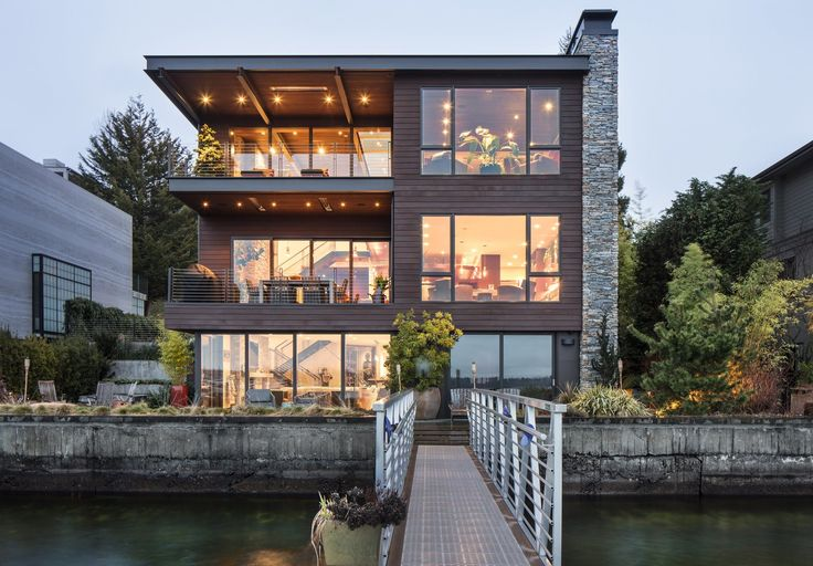 """The home's exterior materials are primarily stained horizontal clear cedar planks from British Columbia, COR-TEN steel panels wrapping the garage and stair elements, and Montana ledgestone applied to the vertical fireplace chimneys,"" says architect Rick Chesmore. Landscaping is by the Nussbaum Group. (Steve Ringman/The Seattle Times)"