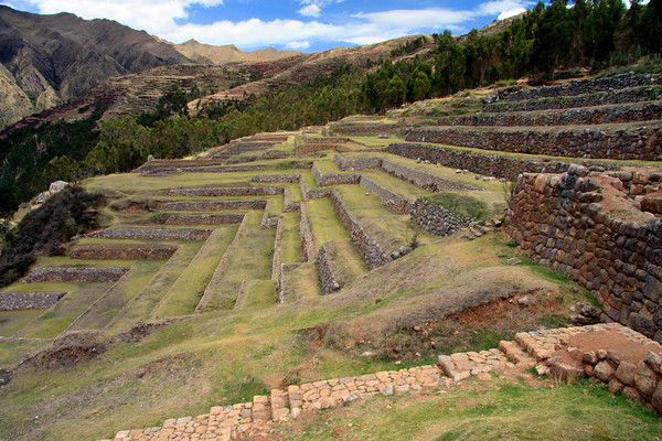 Chinchero Ruins - from the stone stairway to the limestone rock-wall agricultural terraces - along the slope of the Vilcanota Mountains - Cusco department.