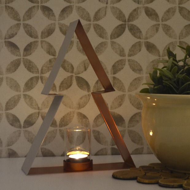 Yuletide's simple lines make it perfect for every décor. Equally at home in a minimalist or traditional style home, this candle holder brings Christmas to your home in understated style.  Available at www.dalaur-creative.com