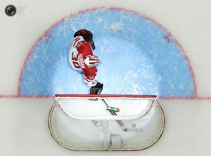 Canada's Malcolm Subban retrieves the puck after being scored on by Team USA during their semi-final game at the 2013 IIHF U20 World Junior Hockey Championship in Ufa