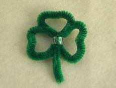 Pipe Cleaner Shamrock Pin    Show off your Irish spirit with the wearing of the green - that is the green shamrock pin you craft following our simple instructions. http://www.craftelf.com/St.Patricks_Day_Pipecleaner_Shamrock_Pin_craft.htm#