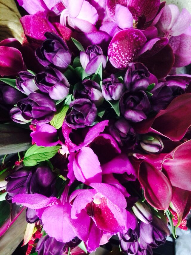 Purple arrangement with orchids and tulips